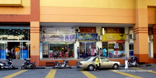 Bus ticket agents on Jalan Ria near KOMTAR bus station