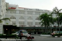 Photo of the front of the Eastern And Oriental Hotel in Georgetown Penang Malaysia