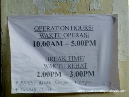 Opening hours posted outside KTM office in Penang