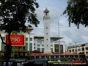 Padang Besar bus waiting in front of the clock tower in Hat Yai